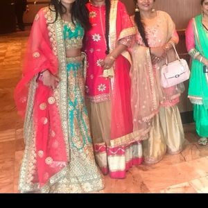 Green lengha with pink dupatta